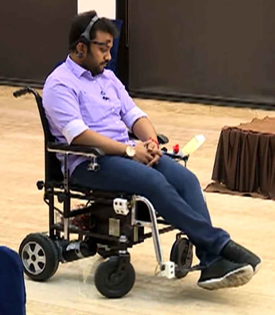 Diwakar Vaish demonstrating how the mind-controlled wheelchair works