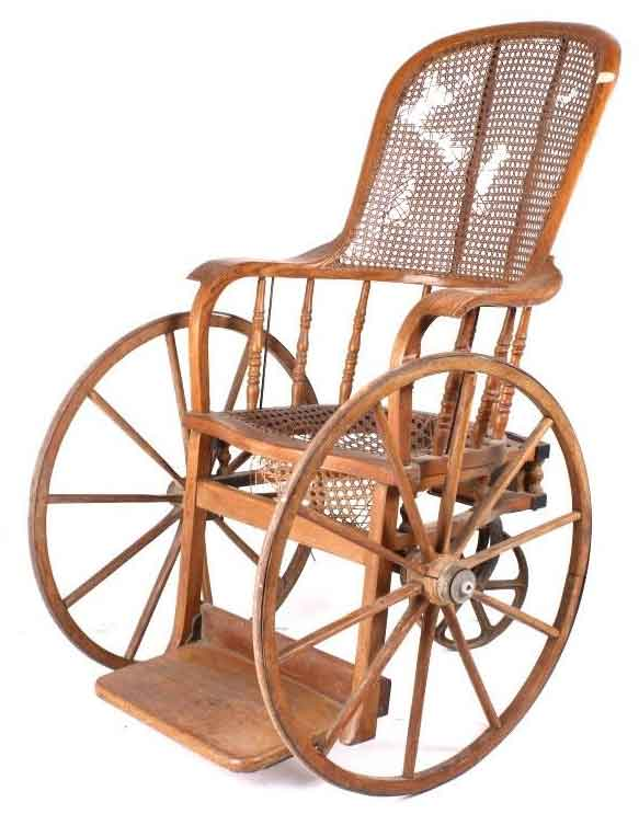 wooden spiked wheelchair